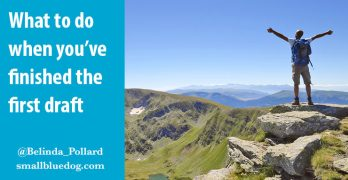 Man standing on high mountain in triumph, with text: What to do when you've finished the first draft