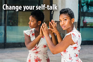 Change your self-talk. Woman reflected in mirror.